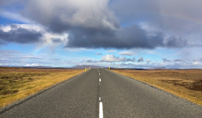 A road heading into a flat horizon in the plains