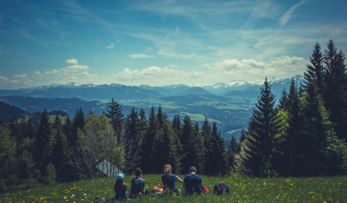 Photos of people overlooking mountains
